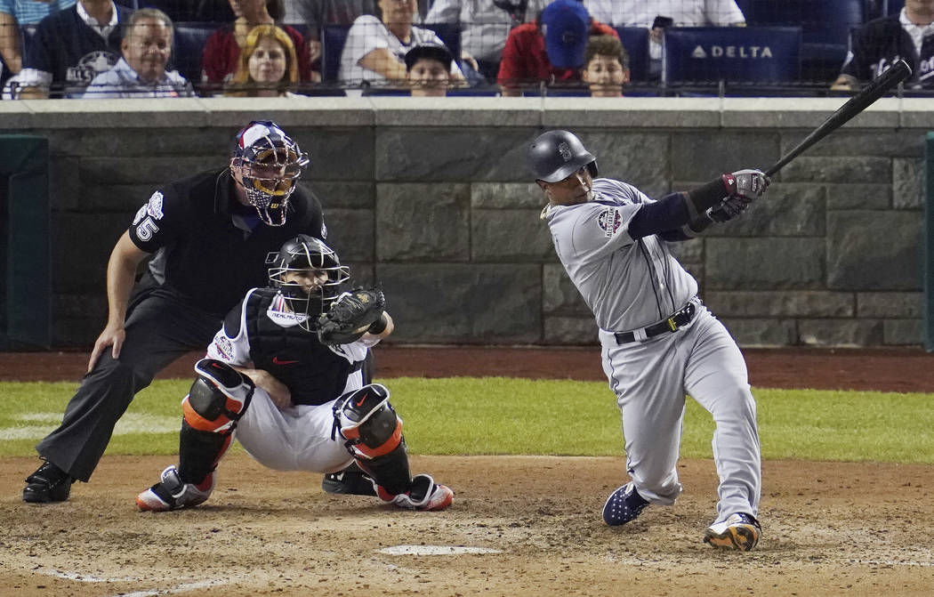 Seattle Mariners Jean Segura (2) hits a three-run homer in the eighth inning during the 89th MLB baseball All-Star Game, Tuesday, July 17, 2018, at Nationals Park, in Washington. (AP Photo/Carolyn ...