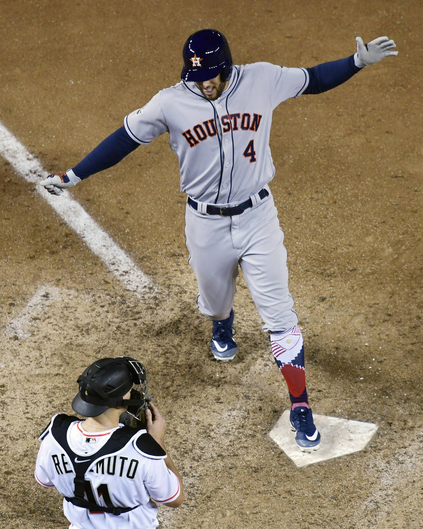 Houston Astros George Springer (4) celebrates his solo home run in the tenth inning as he step on home plate during the Major League Baseball All-star Game, Tuesday, July 17, 2018 in Washington. T ...