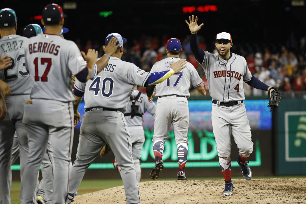 Houston Astros George Springer (4) celebrates with his teammates at the end of the Major League Baseball All-star Game, Wednesday, July 18, 2018 in Washington. The American League won 8-6. (AP Pho ...
