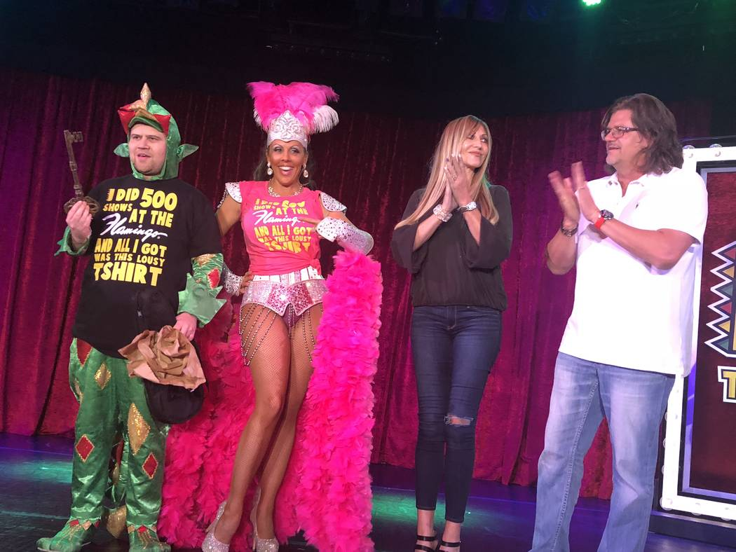 John Van der Put as Piff the Magic Dragon, Jade Simone and Angela and Matt Stabile are shown after the Stabiles presented him with the commemorative Key to the Dressing Room at Flamingo Las Vegas' ...