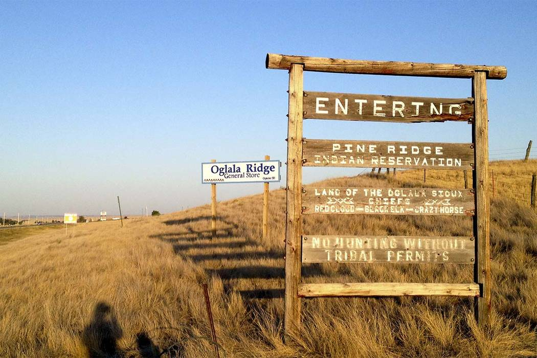 This Sept. 9, 2012 file photo shows the entrance to the Pine Ridge Indian Reservation in South Dakota. (Kristi Eaton/AP file)