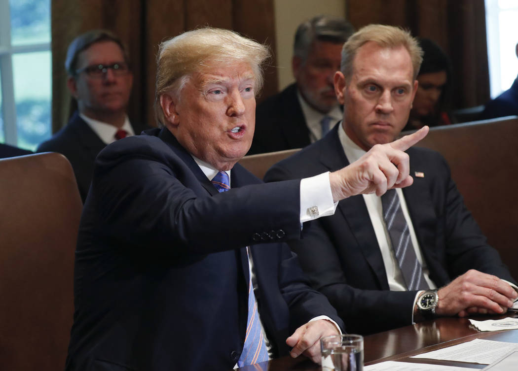 President Donald Trump gestures while speaking during his meeting with members of his cabinet in Cabinet Room of the White House in Washington, Wednesday, July 18, 2018. Looking on is Deputy Secre ...