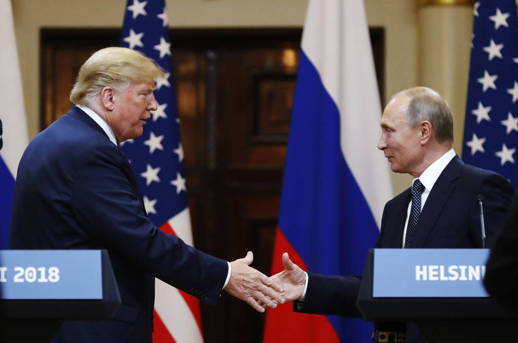 U.S. President Donald Trump shakes hand with Russian President Vladimir Putin at the end of the press conference after their meeting at the Presidential Palace in Helsinki, Finland, Monday, July 1 ...