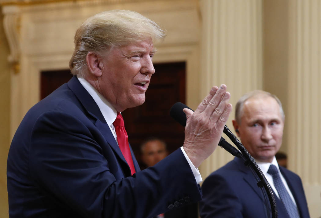 President Donald Trump speaks with Russian President Vladimir Putin during a press conference after their meeting at the Presidential Palace in Helsinki, Finland, Monday, July 16, 2018. (Pablo Mar ...