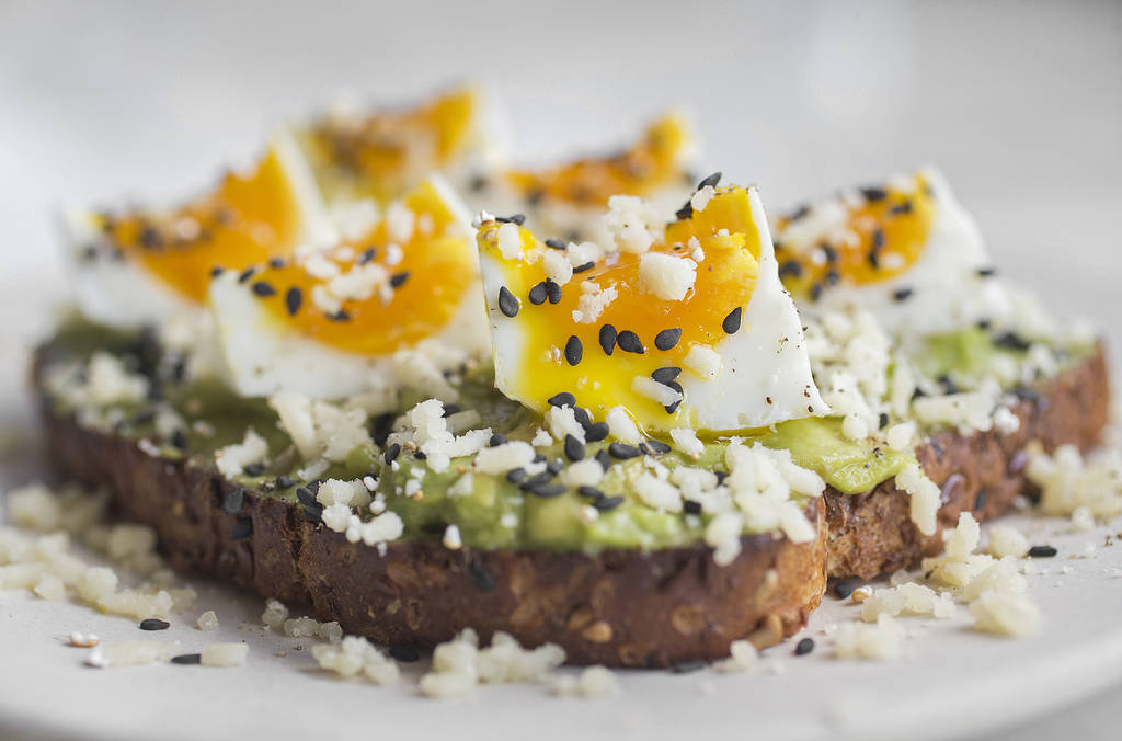 Crushed avocado toast with soft egg, black sesame and white cheddar at Flower Child on Friday, July 20, 2018, in Las Vegas. Benjamin Hager Las Vegas Review-Journal @benjaminhphoto