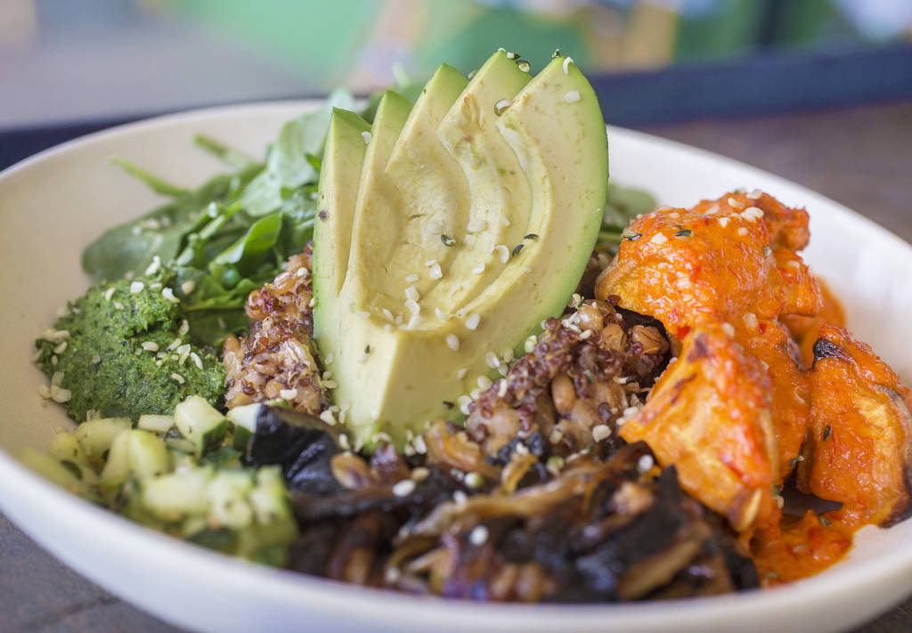 Mother earth with ancient grains, sweet potato, portobello mushroom, avocado, cucumber, broccoli pesto, charred onion, leafy greens, red pepper miso vinaigrette and hemp seed at Flower Child on Fr ...