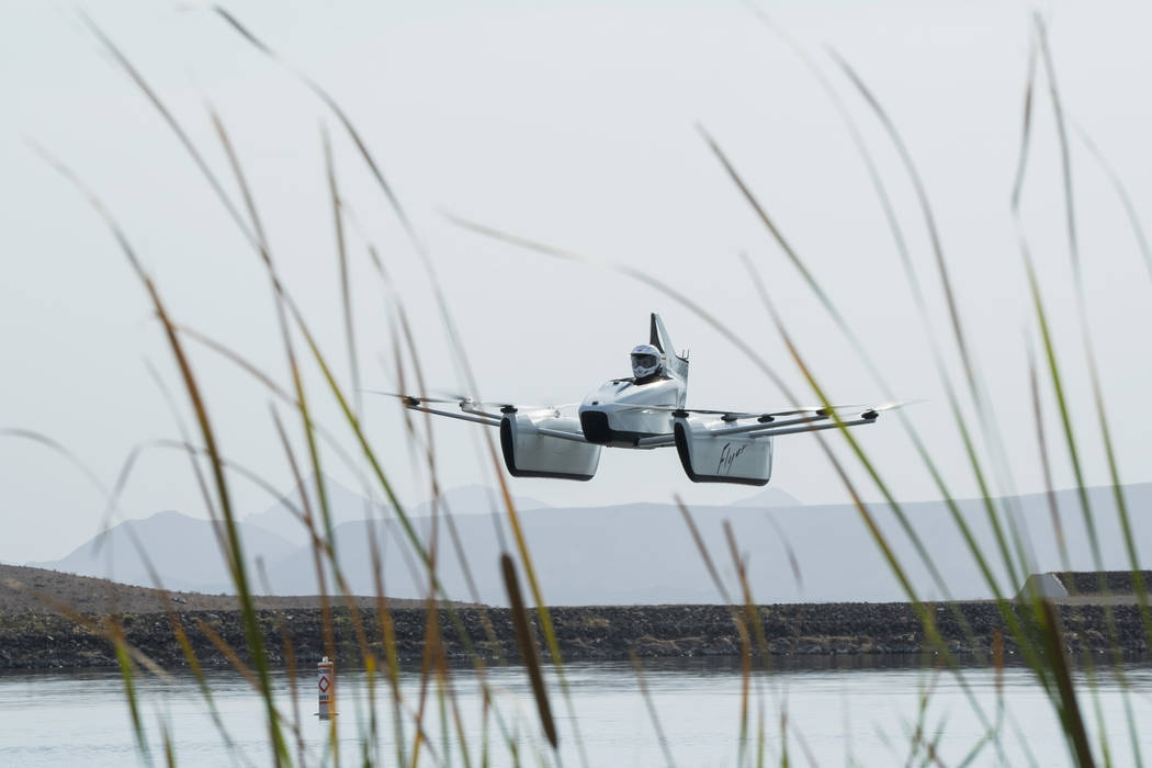 "Flight training manager Brittney Miculka pilots the ""Flyer"" over Lake Las Vegas, Wednesday, July 18, 2018. (Marcus Villagran/Las VegasReview-Journal) @brokejournalist"