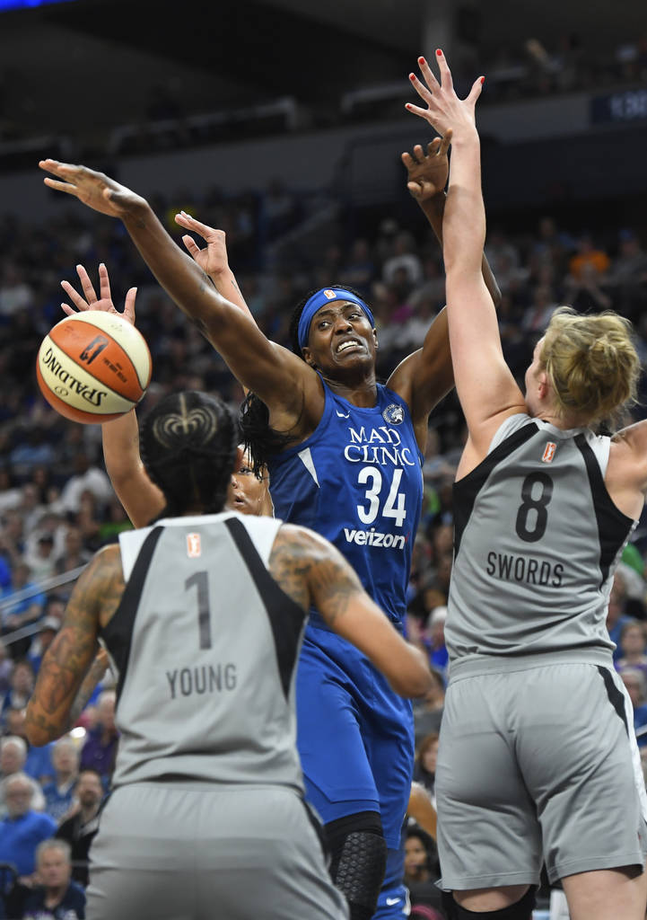 Minnesota Lynx center Sylvia Fowles (34) is fouled during a layup-attempt by Las Vegas Aces center Carolyn Swords (8) in the first quarter of a WNBA basketball game in Minneapolis, Friday, July 13 ...