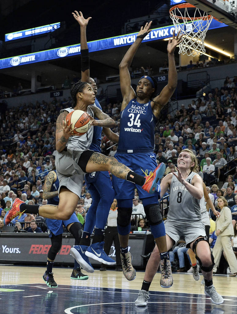 Las Vegas Aces forward Tamera Young (1) is fouled by Minnesota Lynx center Sylvia Fowles (34) during a layup attempt during the second half of a WNBA basketball game Friday, July 13, 2018, in Minn ...