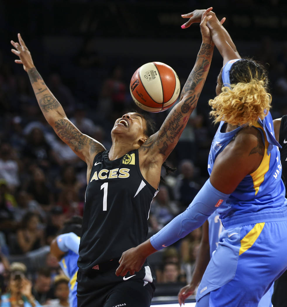Las Vegas Aces forward Tamera Young (1) loses control of the ball in front of Chicago Sky forward Cheyenne Parker (32) during the second half of a WNBA basketball game at Mandalay Bay Events Cente ...
