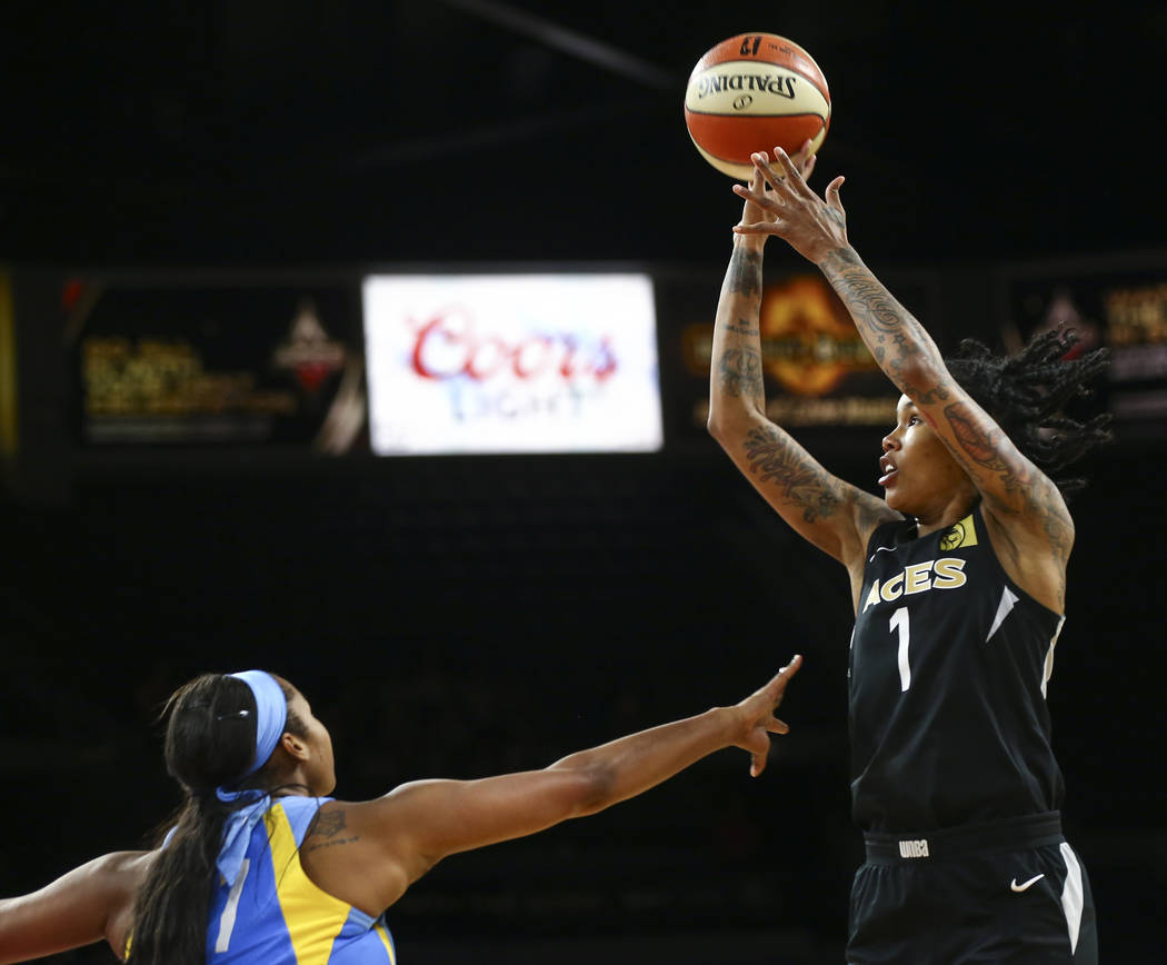 Las Vegas Aces forward Tamera Young (1) shoots over Chicago Sky center Alaina Coates (41) during the second half of a WNBA basketball game at Mandalay Bay Events Center in Las Vegas on Thursday, J ...