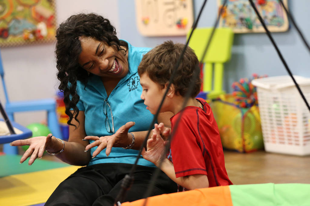 Samuel Mateo, 8, works with registered behavior technicia Doris Lofton during his session at the Touro University Nevada Center for Autism and Developmental Disabilities in Henderson, Tuesday, Jul ...
