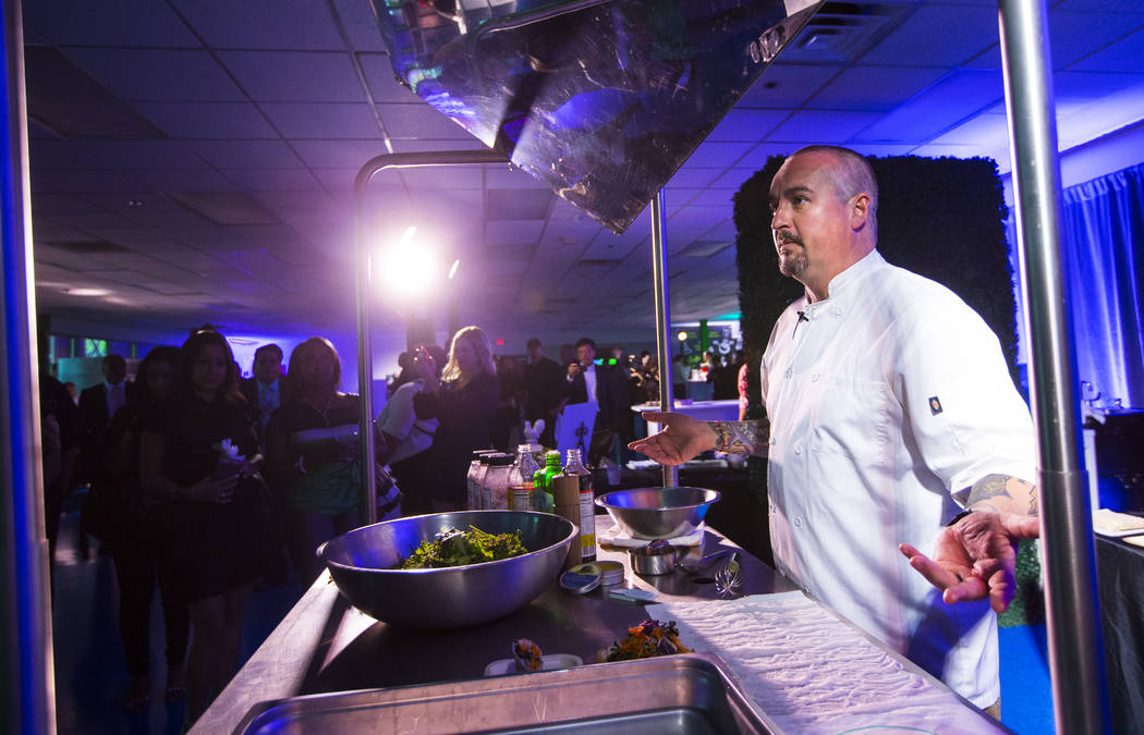 Chef Johnny Church prepares a dish including ingredients using Evercress, the produce made by Oasis Biotech, an indoor farming company, during the grand opening event in Las Vegas on Wednesday, Ju ...