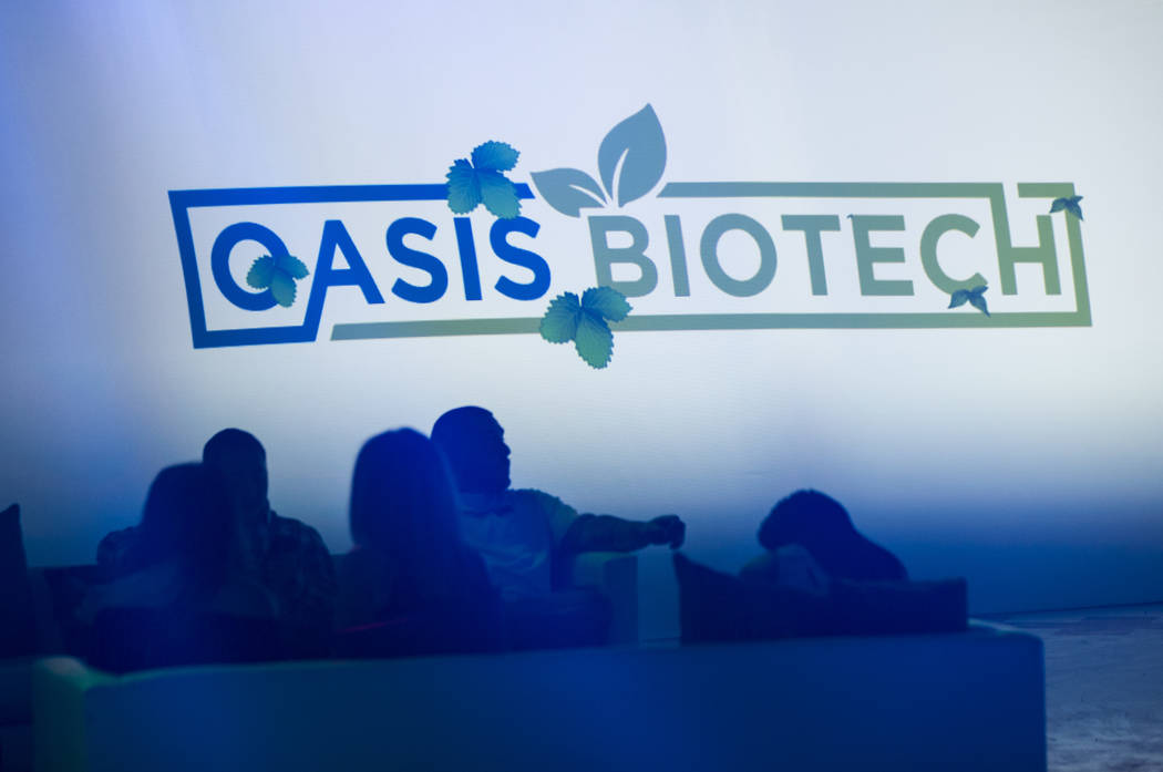 Attendees are silhouetted during a grand opening event at Oasis Biotech, an indoor farming company, in Las Vegas on Wednesday, July 18, 2018. Chase Stevens Las Vegas Review-Journal @csstevensphoto
