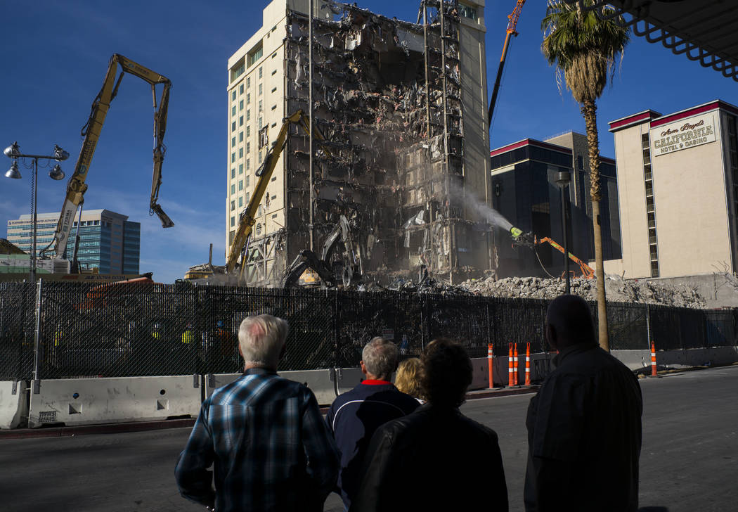People watch the demolition of the Las Vegas Club continue in downtown Las Vegas on Friday, Dec. 15, 2017. The property was purchased by Derek and Greg Stevens in 2015. Chase Stevens Las Vegas Rev ...