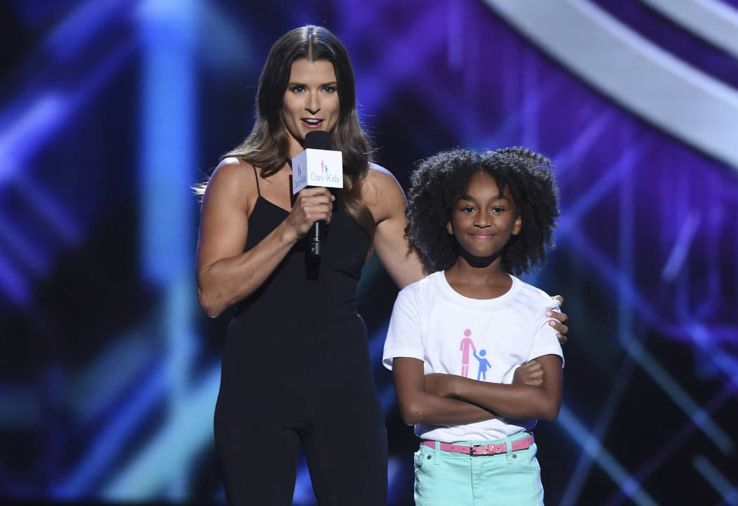 Danica Patrick, left, and Aalyrah Caldwell appear at the ESPY Awards at Microsoft Theater on Wednesday, July 18, 2018, in Los Angeles. (Photo by Phil McCarten/Invision/AP)