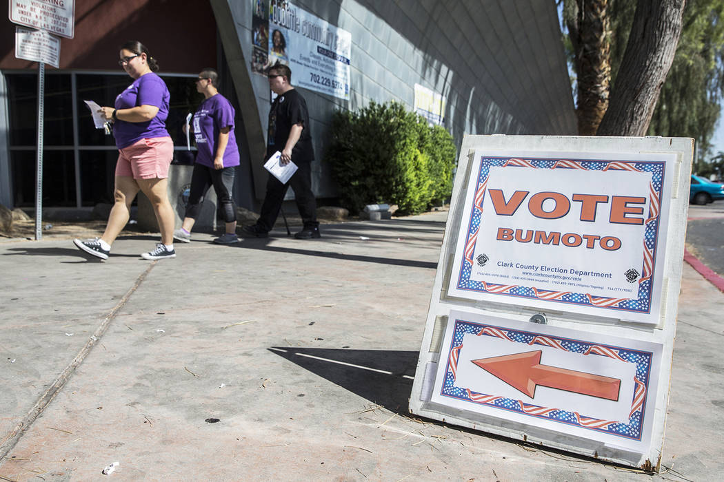 Las Vegas and North Las Vegas city councils have approved an agreement with the Clark County election department that allows voters in municipal elections to cast ballots at vote centers. (Benjami ...