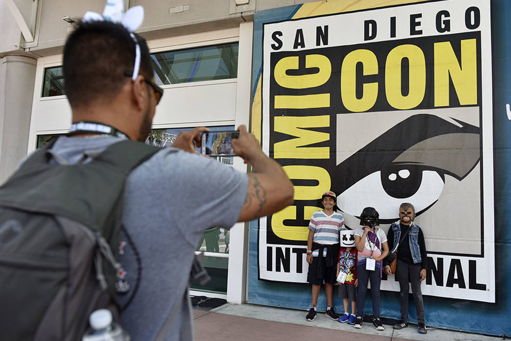 Luis Ramos, left, of San Diego takes a picture of his son Alek, 6, third from right, and daughter Anabel, 11, second from right, and their friends Emiliano Beltran, 12, fourth from right, and Isab ...