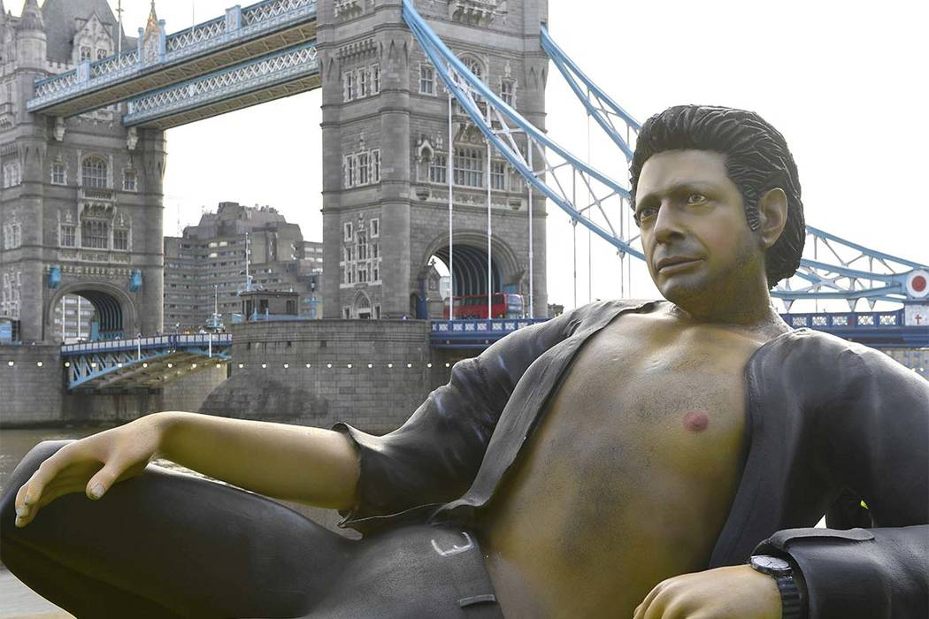"""A 25-foot statue of actor Jeff Goldblum in a pose from a scene in the first """"Jurassic Park"""" movie, popped up at Potters Fields Park, London, Wednesday July 18, 2018. (Doug Peters/PA via AP)"""