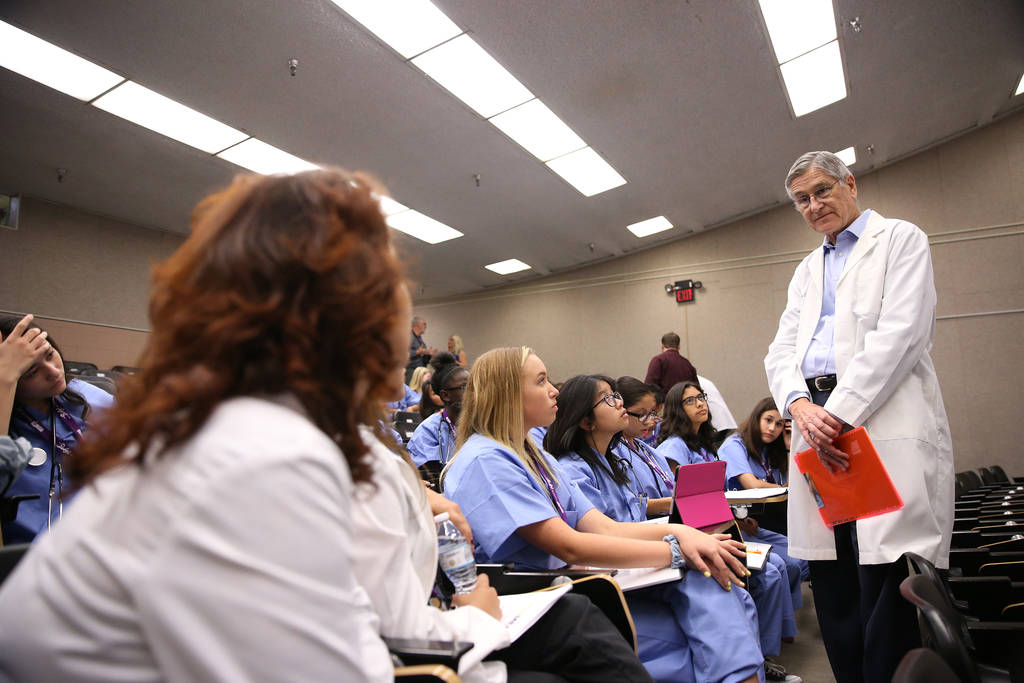 Dr. Jerry Reeves instructs students during CampMED at UNLV in Las Vegas, Friday, July 20, 2018. In CampMED, students interested in the medical field as a career attend labs and workshops with prof ...