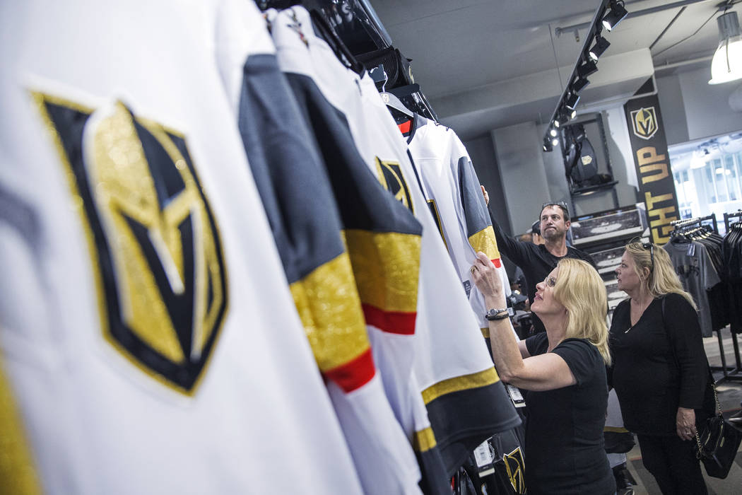 "Charmaine Pennington, left, shops for Golden Knights jerseys on Wednesday, April 18, 2018, at The Arsenal, in Las Vegas. ""We're buying one for our son who's in the Air Force in North Carolina ..."