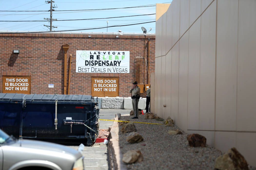 Las Vegas police investigate in an alley behind a motel near the northeast corner of Sahara Avenue and Las Vegas Boulevard where a shooting left one man dead Thursday, July 19, 2018. K.M. Cannon L ...