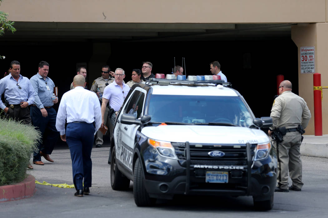 Las Vegas police investigate near an alley behind a motel near the northeast corner of Sahara Avenue and Las Vegas Boulevard where a shooting left one man dead Thursday, July 19, 2018. K.M. Cannon ...