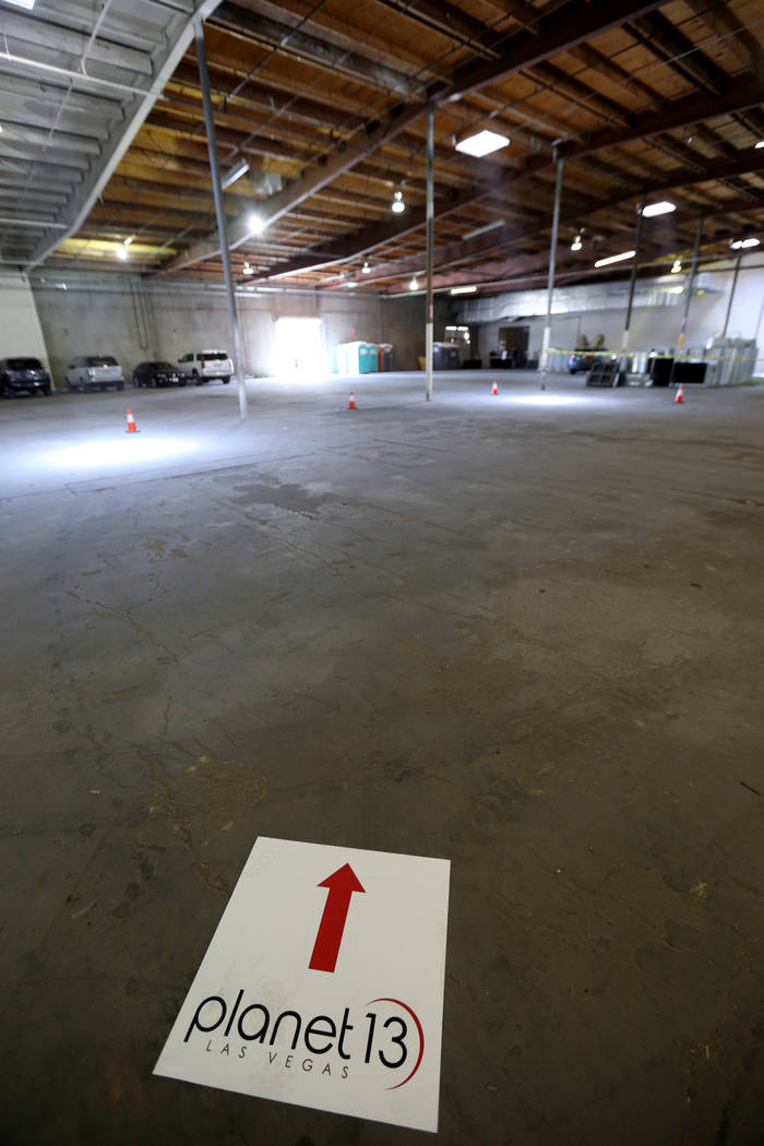 Signs direct guests to an event at the under-construction Planet 13 Superstore dispensary, a cannabis entertainment complex at 2548 W. Desert Inn Road in Las Vegas, Thursday, July 19, 2018. Compan ...