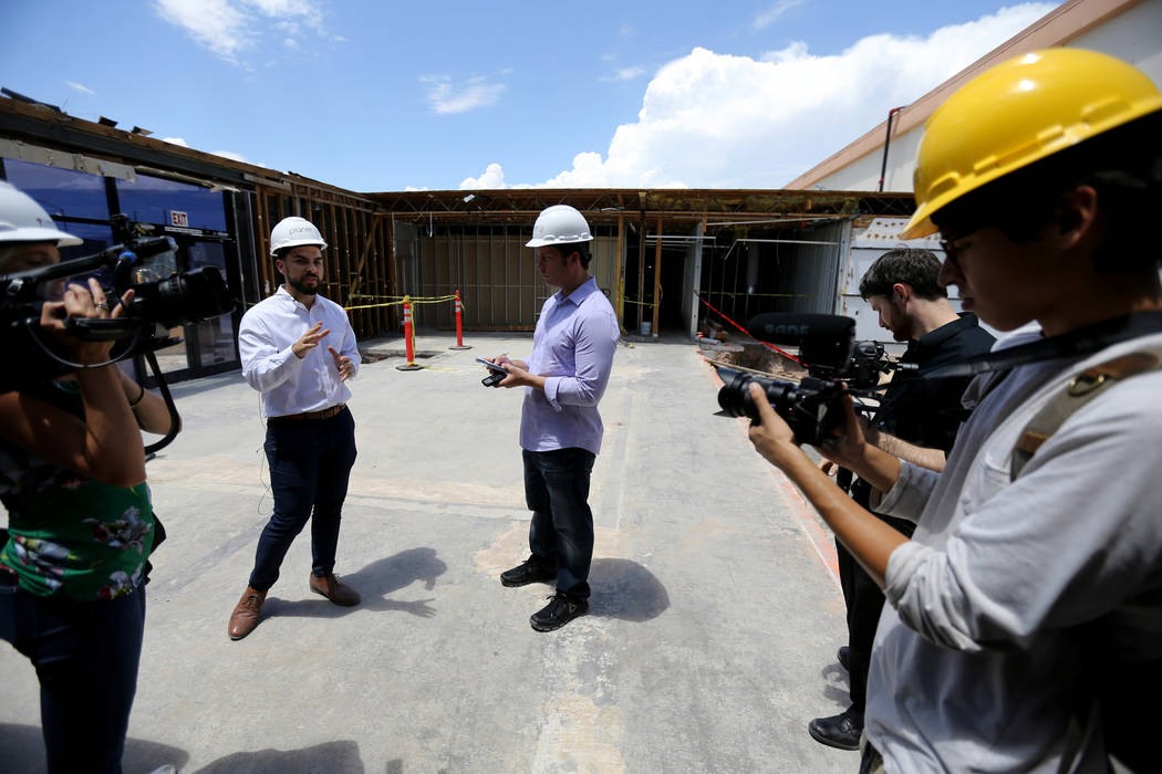 Director of Marking David Farris, second from left, leads a tour during an event at the under-construction Planet 13 Superstore dispensary, a cannabis entertainment complex at 2548 W. Desert Inn R ...
