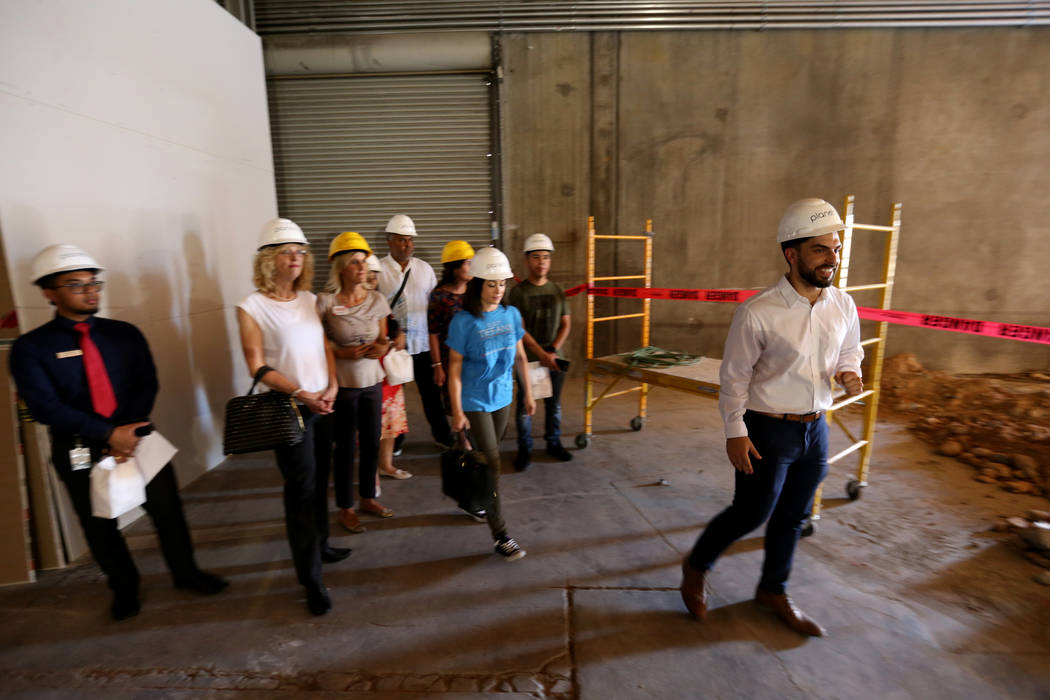 Director of Marking David Farris, right, leads a tour during an event at the under-construction Planet 13 Superstore dispensary, a cannabis entertainment complex at 2548 W. Desert Inn Road in Las ...
