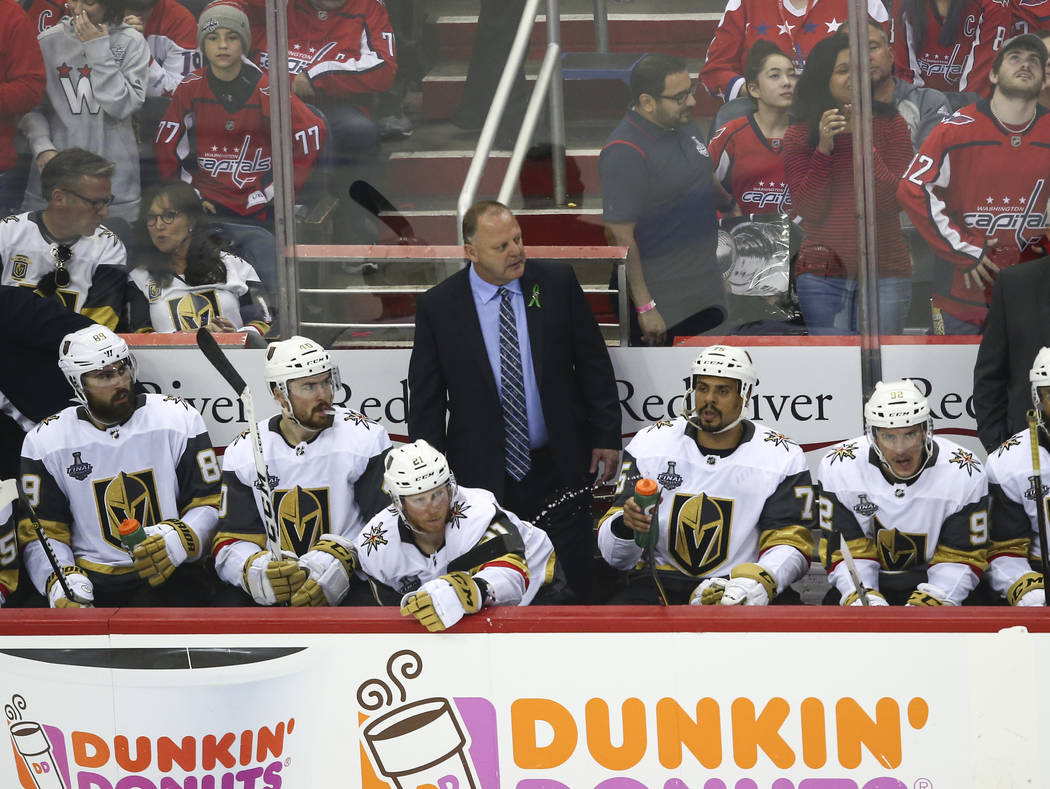 Golden Knights head coach Gerard Gallant, center, looks on during the third period of Game 3 of the NHL hockey Stanley Cup Final against the Washington Capitals at Capital One Arena in Washington ...