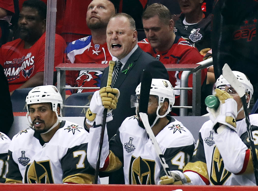 Vegas Golden Knights head coach Gerard Gallant watches from behind the bench during the third period in Game 4 of the NHL hockey Stanley Cup Final against the Washington Capitals, Monday, June 4, ...