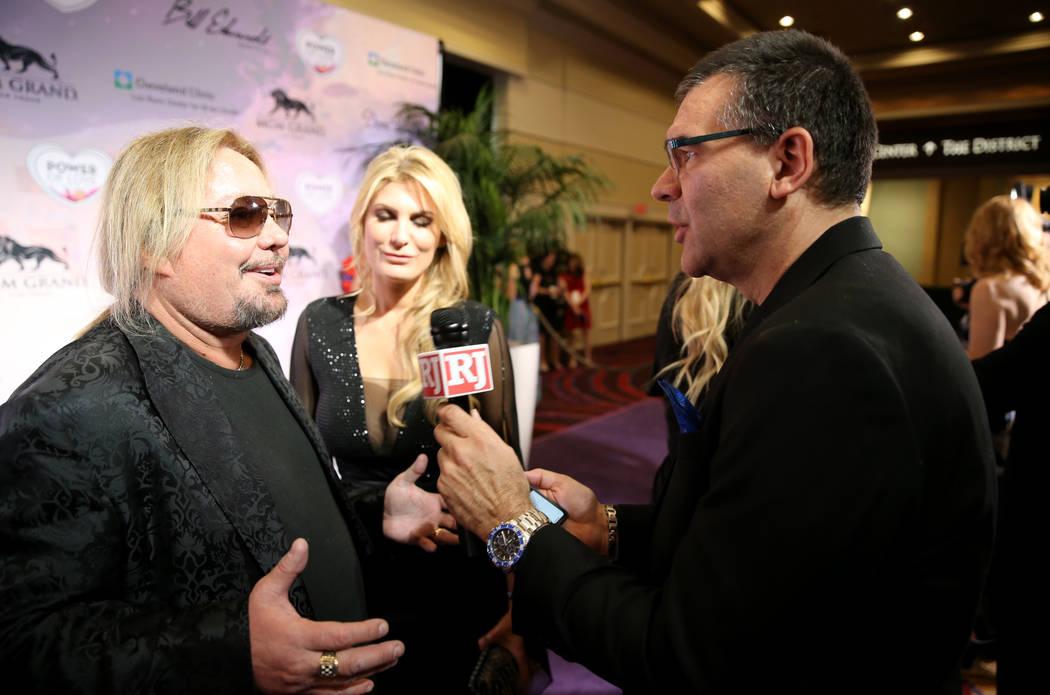 Motley Crue frontman Vince Neil talks to Las Vegas Review-Journal columnist John Katsilometes on the purple carpet 22nd annual Power of Love gala in the MGM Grand Garden Arena in Las Vegas Saturda ...