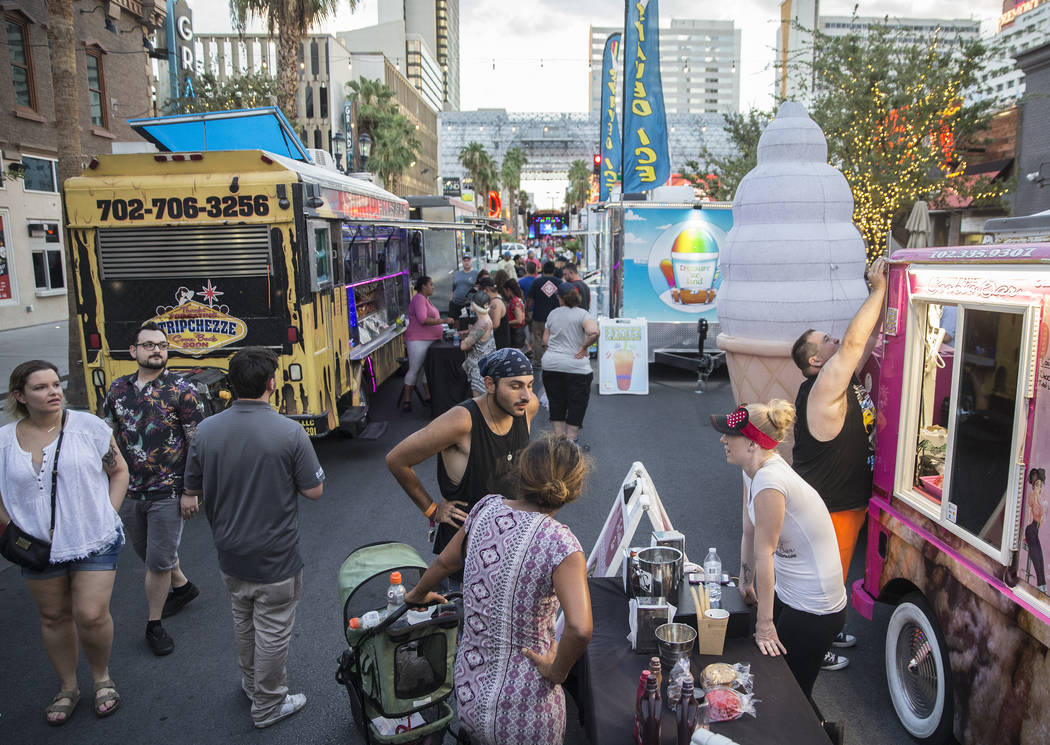 Attendees walk down a row of food trucks on North 3rd Street between Ogden and Stewart Avenue during Third Thursday on Thursday, July 19, 2018, in Las Vegas. Benjamin Hager Las Vegas Review-Journa ...