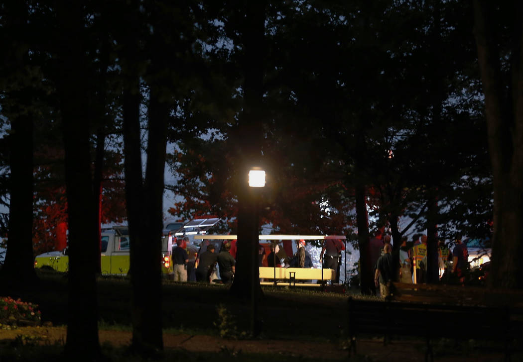 Emergency responders work at Table Rock Lake after a deadly boat accident in Branson, Mo., Thursday, July 19, 2018. A sheriff in Missouri said a tourist boat has apparently capsized on the lake, l ...