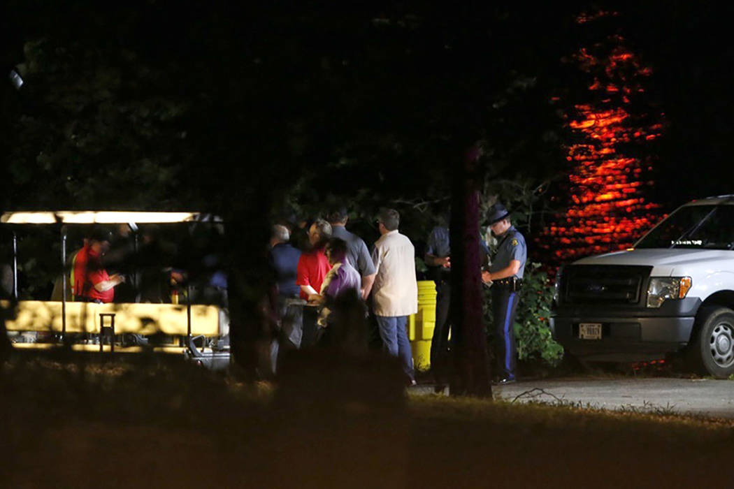 Rescue crews work at the scene of a deadly boat accident at Table Rock Lake in Branson, Mo., Thursday, July 19, 2018. A sheriff in Missouri said a tourist boat has apparently capsized on the lake, ...