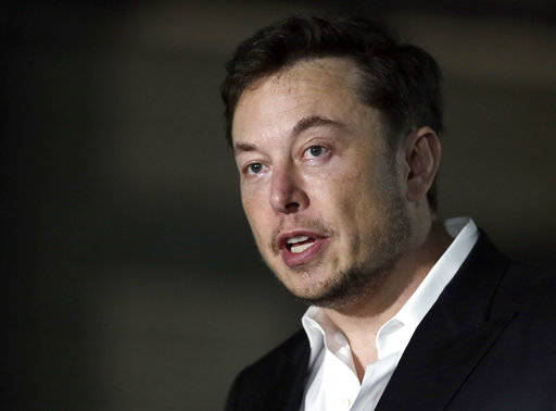 FILE - In a Thursday, June 14, 2018 file photo, Tesla CEO and founder of the Boring Company Elon Musk speaks at a news conference, in Chicago. Whether it's investors betting against his sto ...