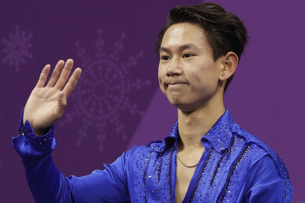 Figure skater Denis Ten, of Kazakhstan, reacts as his score is posted following his performance in the men's short program figure skating, in the Gangneung Ice Arena at the 2018 Winter Olympics in ...