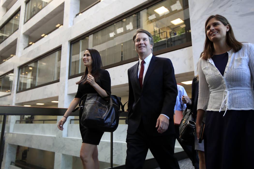 Supreme Court nominee Brett Kavanaugh, walks to meet Sen. Dean Heller, R-Nev., on Capitol Hill in Washington, Thursday, July 19, 2018. (AP Photo/Manuel Balce Ceneta)