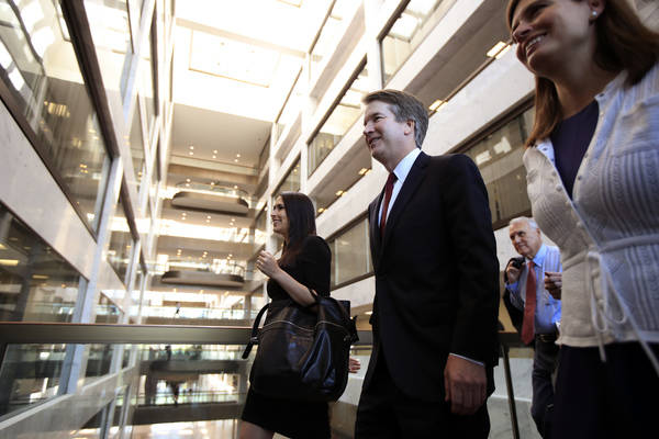 Supreme Court nominee Brett Kavanaugh, walks to meet Sen. Dean Heller, R-Nev., on Capitol Hill in Washington, Thursday, July 19, 2018. (Manuel Balce Ceneta/AP)