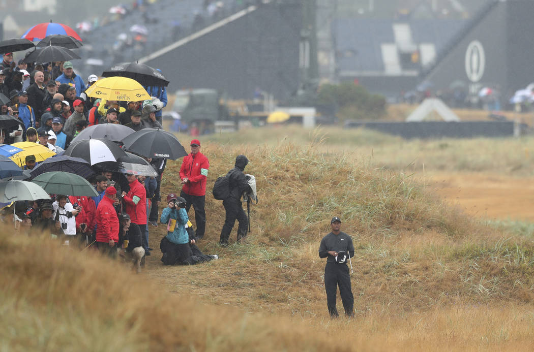 Tiger Woods of the US stands in the rough on the 2nd hole during the second round of the British Open Golf Championship in Carnoustie, Scotland, Friday July 20, 2018. (AP Photo/Jon Super)