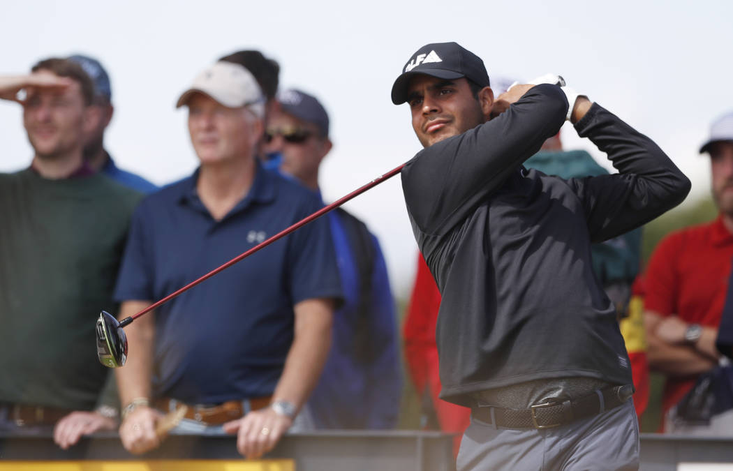 Shubhankar Sharma of India plays off the 10th tee during a practice round ahead of the British Open Golf Championship in Carnoustie, Scotland, Wednesday July 18, 2018. (AP Photo/Alastair Grant)