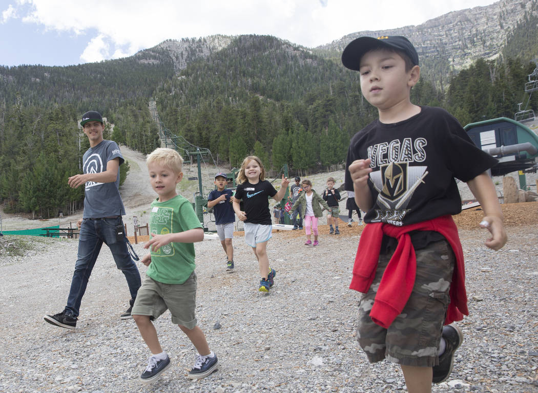 Garrett Chappen, right, leads a group of kids to lunch during Youth Adventure Day at Lee Canyon on Friday, July 20, 2018, in Las Vegas. Benjamin Hager Las Vegas Review-Journal @benjaminhphoto