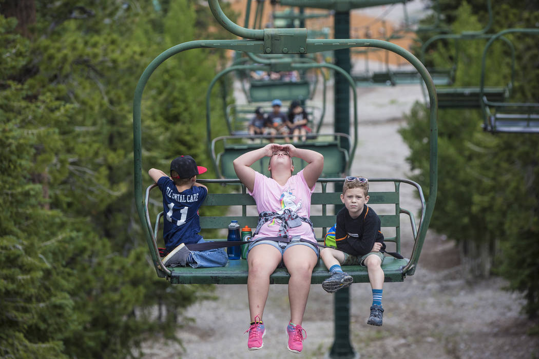 Weston Gregory, left, Khloe Wright and Cameron Vance ride the Sherwood ski lift during Youth Adventure Day at Lee Canyon on Friday, July 20, 2018, in Las Vegas. Benjamin Hager Las Vegas Review-Jou ...