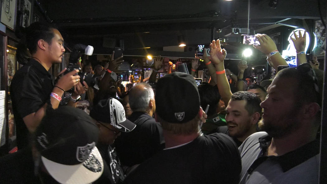 Oakland Raiders head coach Jon Gruden throws t-shirts towards fans at Ricky's Sports Theater and Grill on Friday, July 20, 2018 in San Leandro, Calif. Chris Booker Las Vegas Review-Journal @Bookerc94