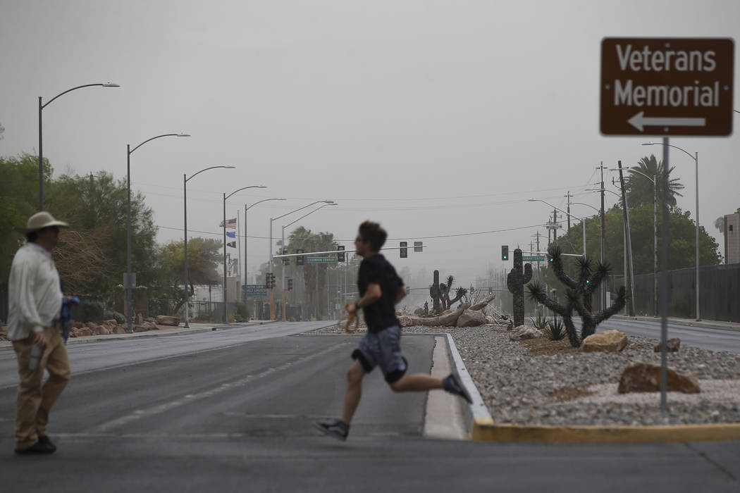 Dust fills the sky as people cross Washington Avenue near the Old Las Vegas Mormon Fort State Historical Park in Las Vegas on Saturday, July 21, 2018. Chase Stevens Las Vegas Review-Journal @csste ...