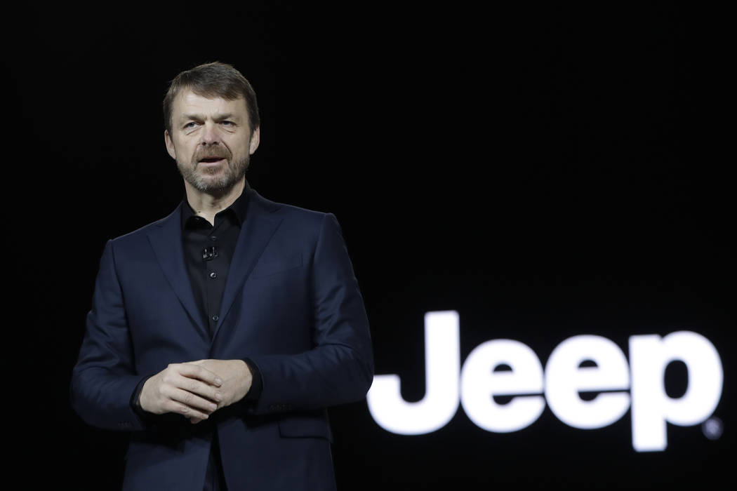 Mike Manley, head of Jeep Brand, introduces the 2019 Jeep Cherokee during the North American International Auto Show, in Detroit, USA on Tuesday, Jan. 16, 2018. (AP Photo/Carlos Osorio, FILE)