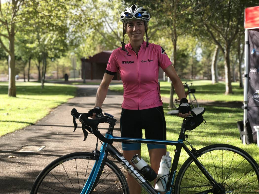 Joann Pavlovcak, 46, poses with her bike after completing a 25-mile ride on the newly-paved Interstate 11. The Southern Nevada Bicycle Coalition hosted the unique ride, offering cyclists a one-tim ...