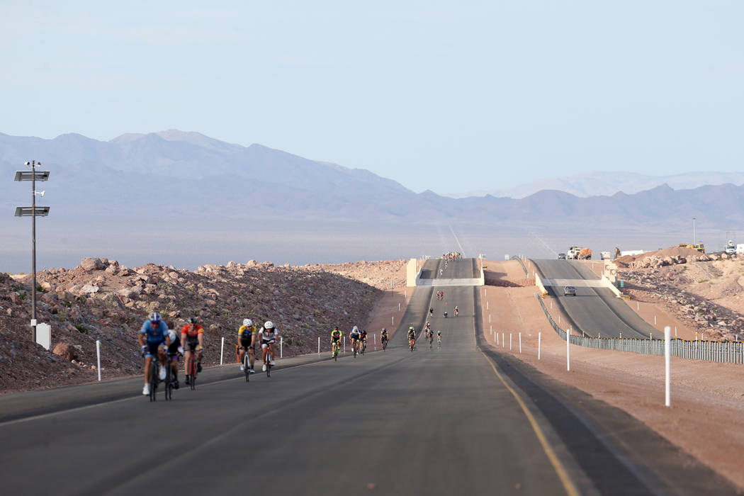 Cyclists ride on the yet-to-be-opened Interstate 11 in Boulder City Saturday, July 21, 2018. The event, sponsored by the Southern Nevada Bicycle Coalition, gave people a chance to ride on the free ...
