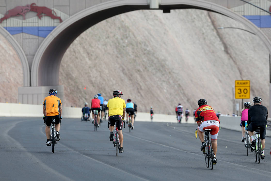 Cyclists ride under a wildlife bridge on the yet-to-be-opened Interstate 11 in Boulder City Saturday, July 21, 2018. The event, sponsored by the Southern Nevada Bicycle Coalition, gave people a ch ...